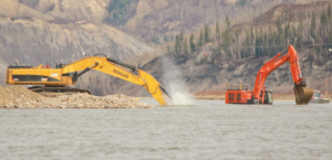 Excavation crews dredge the Peace River near Old Fort in April as part of fish enhancement work just downstream of the Site C dam site. A posting at the Peace Island Park boat launch in Taylor advises boaters of the work.   Photo By Matt Preprost